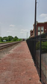 As the train approaches the depot.