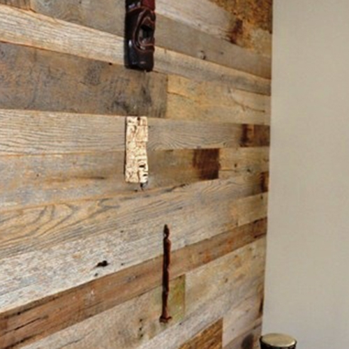 Private residence – Barn wood accent wall going up stairs. Mostly weathered gray, unfinished.