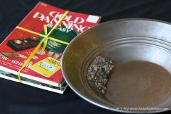 Gold Panning Collection: Books and Pan with Gold Pieces.