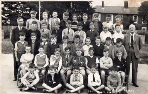 Holbrook School photo 1959 with anti-tank blocks in the background