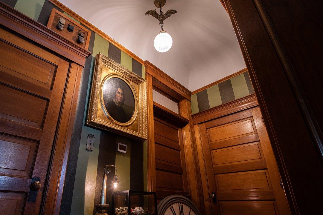 A bronze bat chandelier and a portrait of our ancestor