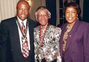 Congressman Edlophus Towns (left) and his wife, Gwen Towns (right) pose with former Congresswoman and Brooklyn native, en:Shirley Chisholm (center)