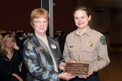 Hall of Fame coordinator Rita Peterson, left, presents National Register plaque to Jennifer Anderson, manager of Staunton State Park. Photo by Matthew Lewis.