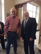 Graphic artist Doyle Harrison with Commissioner Don Rosier.