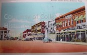 Postcard showing east side of the square. Coffey's Drugs is on the far right.