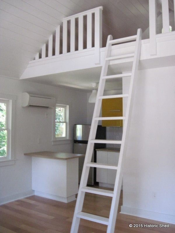 The steep roof allowed a storage loft to be placed over the kitchen and bath area