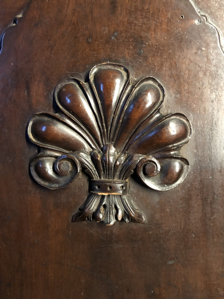 Close-up of Carved Shell Detail on Antique Grandfather Clock Case