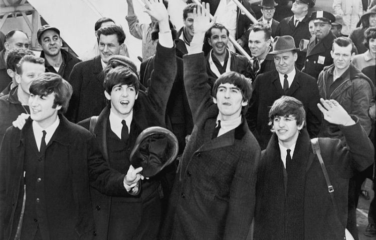 The Beatles bij hun aankomst in Amerika in 1964