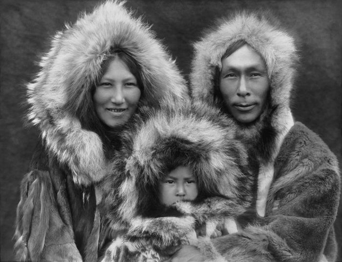 Eskimo mother, father, and son (1929)