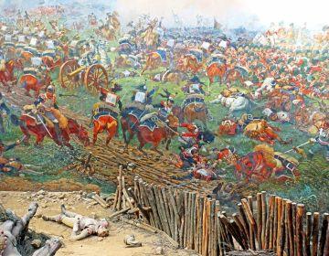 Dennis Jarvis' Waterloo-panorama -detail met Wellington rechtsboven schuilend in een infanterie-square tijdens Franse cavalerieaanval