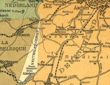 Neutraal Moresnet op een (ansicht)kaart van begin vorige eeuw, ingeklemd tussen Nederland, België en Duitsland, met het Vierlandenpunt onder Vaals.