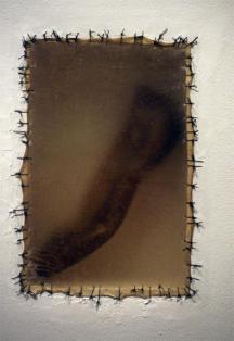 Doris Salcedo; Atrabiliarios; 1992-3; shoe, plywood, cow bladder and surgical thread; 11.5 x 7.5 inches
