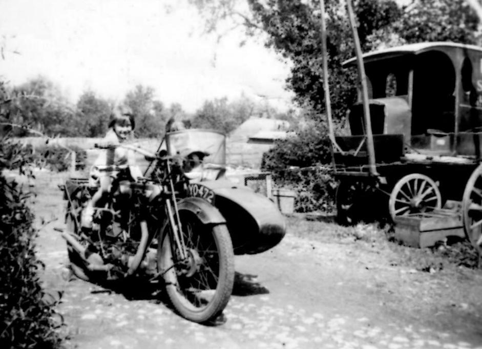 """August 1935. Barbara Billings aged 3 on the Rudge in """"The Opening"""" of 14 Charney (Brook Cottage)."""