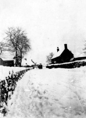Main St looking North. Rectory Farm on right.
