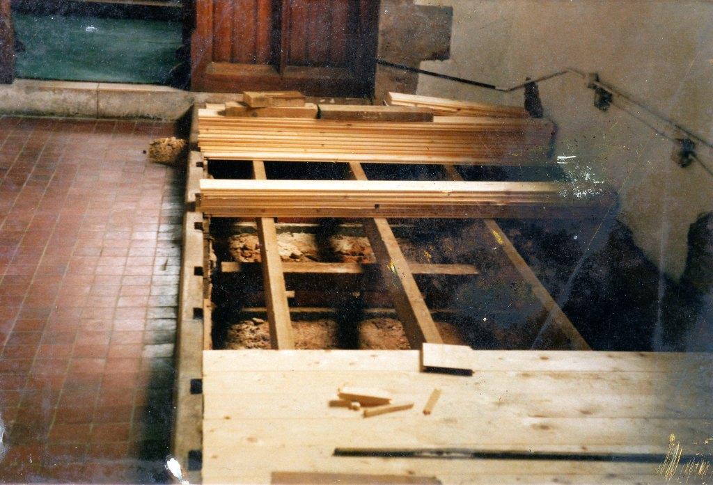 Flooring being renewed under the pews