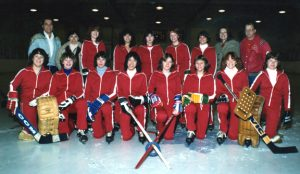 1981-1982 Junior Belle Rep Team Calgary Raiders Back Row: Coach John Morcom, Manager Brenda Holdaway, Tracy Wake, Diana Young, Tina Holdaway, Debbie Zold, Karen Redmen, Manager Judy Morcom, Don Henderson Front Row: Leanne Longston, Judy Todd, Dawn Redmond, Holly Ann Lees, Traci Robinson, Jennifer Harper, Shannon Hopps, Darcy McNabb