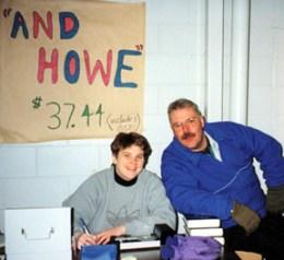 "Ringette Calgary Board Members Laura Webb and Paul Peters work the table selling ""And Howe"" books."