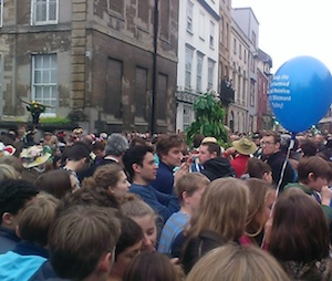 Crowd Including A Tree