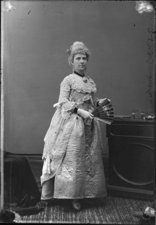 "Mrs. John Courtney as Lady Esmond Warrington (in ""heirloom garments""). http://collectionscanada.gc.ca/pam_archives/index.php?fuseaction=genitem.displayItem&lang=eng&rec_nbr=3477256"