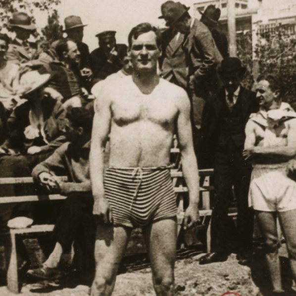 Arthur Cravan photographed at a boxing event on a beach on the beach