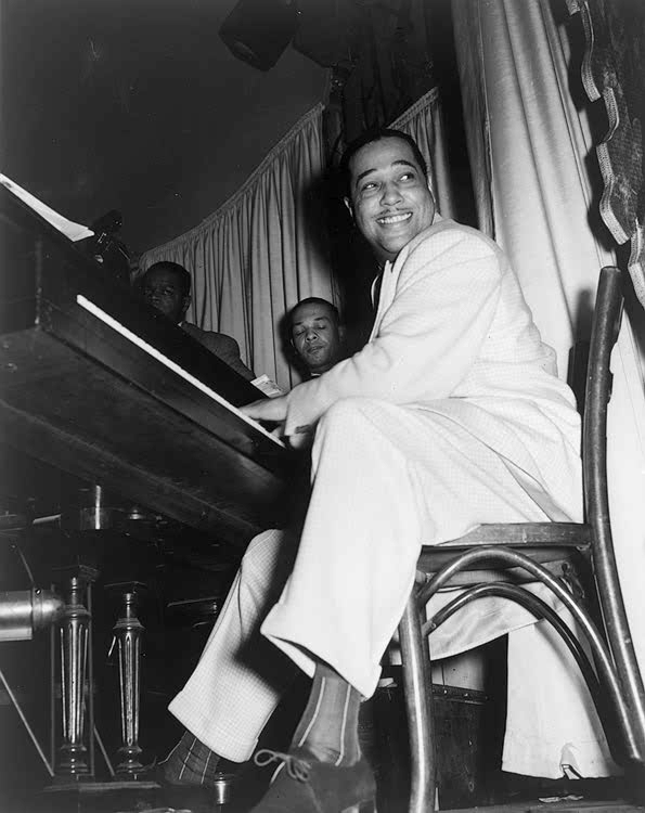 Duke Ellington playing the piano and smiling in 1943