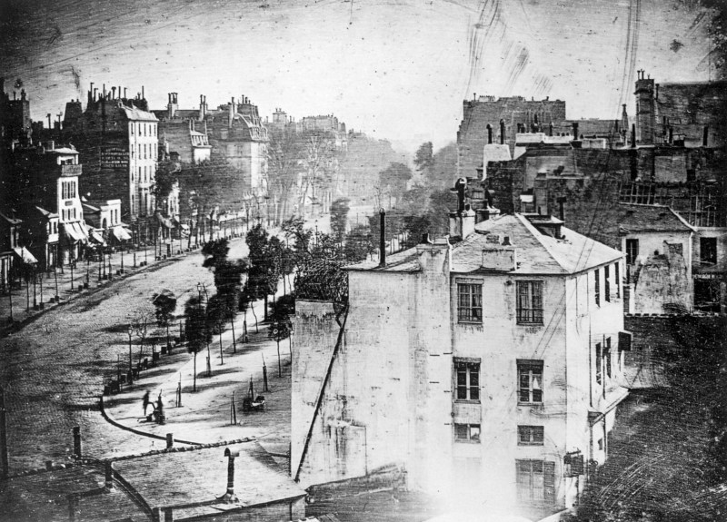 Boulevard du Temple in Paris, France in 1838. It was taken by Louis Daguerre and shows a person having his boots polished near the bottom left of the photograph. It is believed to be the earliest image to show a living person.