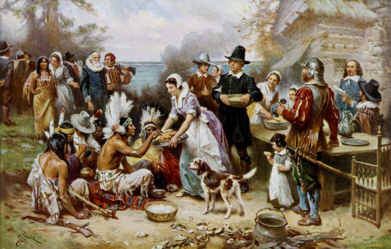 The first thanksgiving 1621 showing pilgrims, native americans sharing food. The image is not accurate.