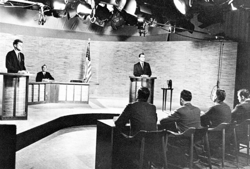 John F. Kennedy and Richard Nixon in front of an audience and behind podiums and the second presidential debate during the 1960 Presidential election campaign.