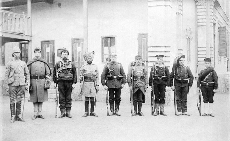 The troops of the Eight Nations Alliance posing for a photograph in China, 1900. Left to right: Britain, United States, Australia (British Empire colony at this time), India (British Empire colony at this time), German Empire, France, Austria-Hungary, Italy, Japan.