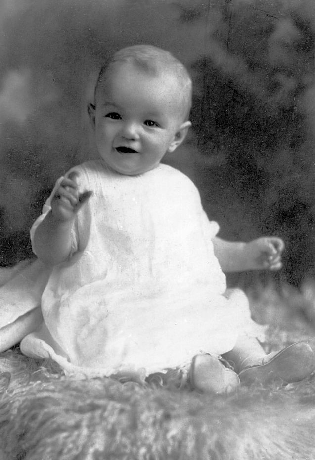 Marilyn Monroe as a baby in 1927 having a professional photo of her taken.