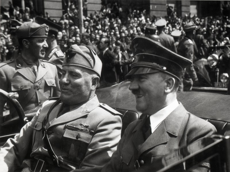 Benito Mussolini and Adolf Hitler sitting in a car together in Munich in June 1940.