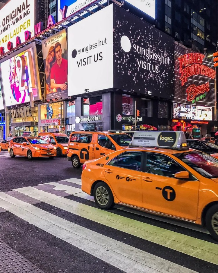 Taxis in Times Square after the Show