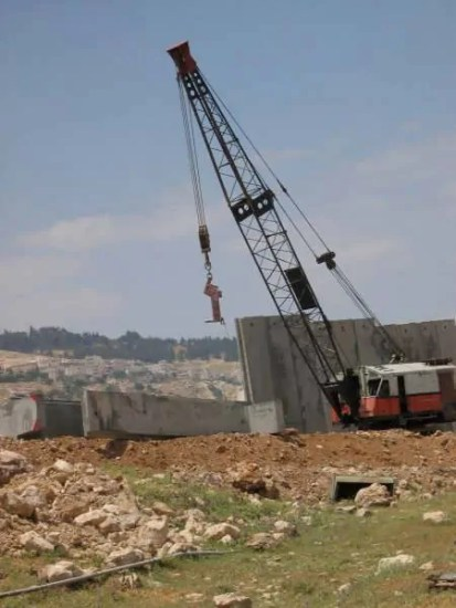 The West Bank Separation Wall being built. Photo by Tamer Halaseh