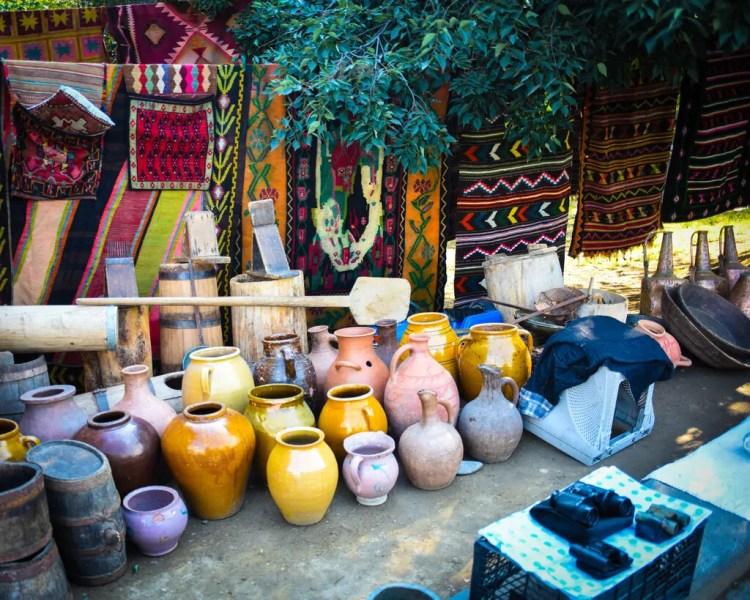 Georgia - Tbilisi - Dry Bridge Market - rugs and vases