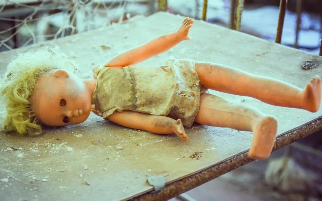 Precarously arranged baby dolls designed to spook as much to evoke sympathy for the children that left them behind.