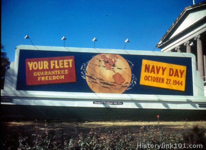 Billboard showing art similar to the poster, Navy Day 1944