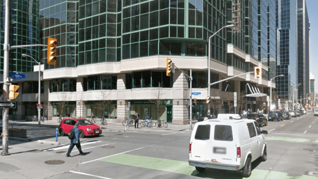 The corner in 2016. Canadian Tire was demolished 2003 to make way for the third Minto Place tower. Image: Google Maps.