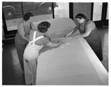Three women sewing plane wing fabric in De Land, Florida, April 1942