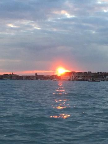 sunset on boat outside Venice