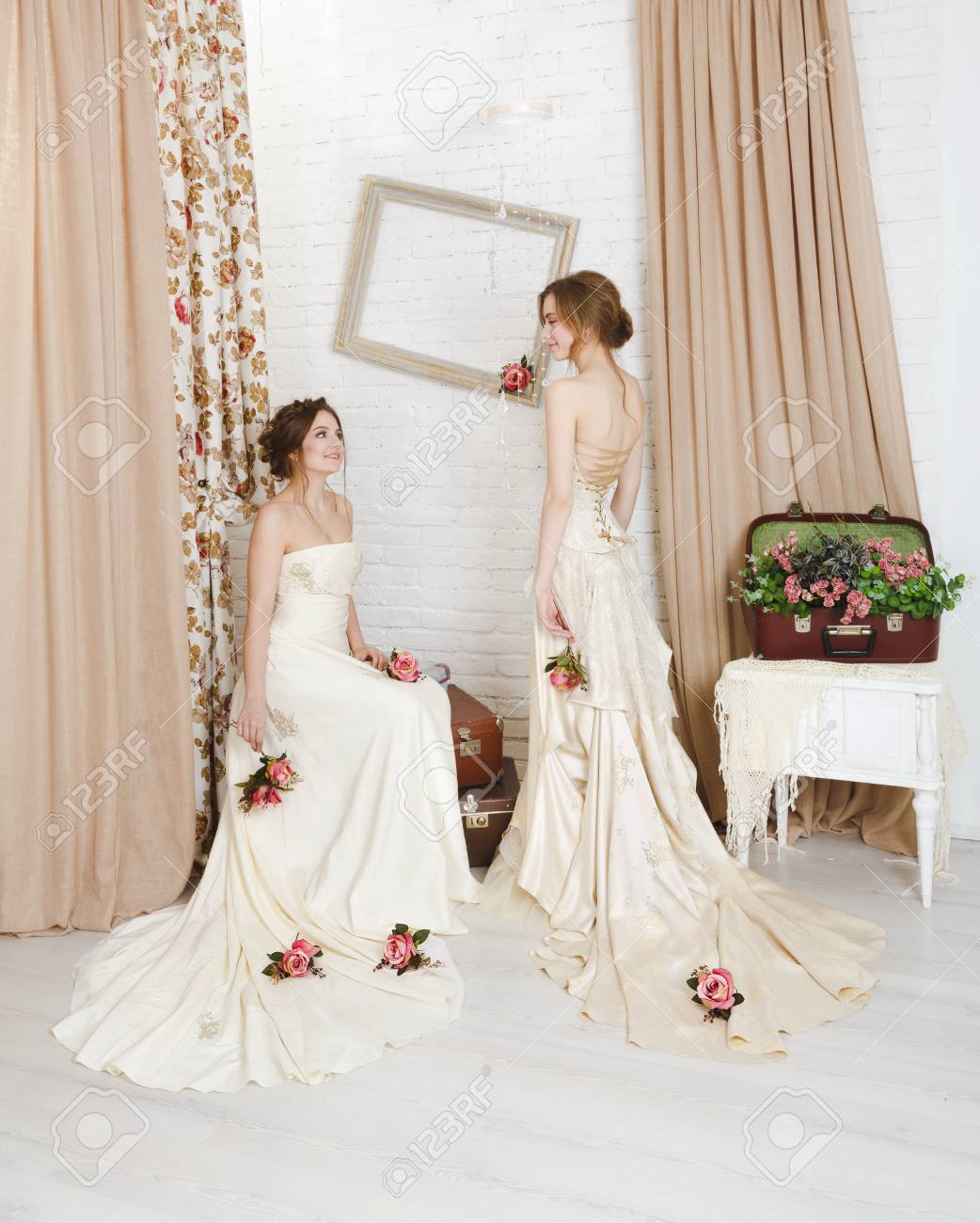 Beautiful young brides in rustic wedding dresses