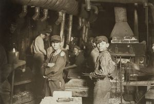 Adolescent boys working the midnight shift in a glass works in Indiana, USA, in 1908.