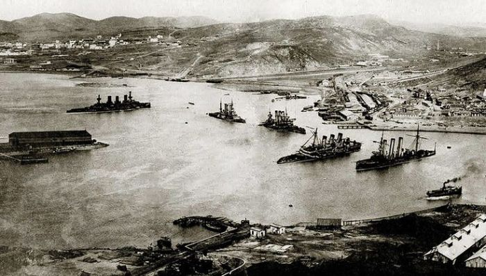 Port Arthur after the surrender. Note the multiple sunken battleships. 203 Hill is at the top left of the picture.