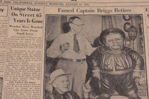 Dick Meade, new owner of Captain Briggs, and Julius Krieg, a former city councilman, who helped carve the statue with his father in 1872 (<em data-recalc-dims=