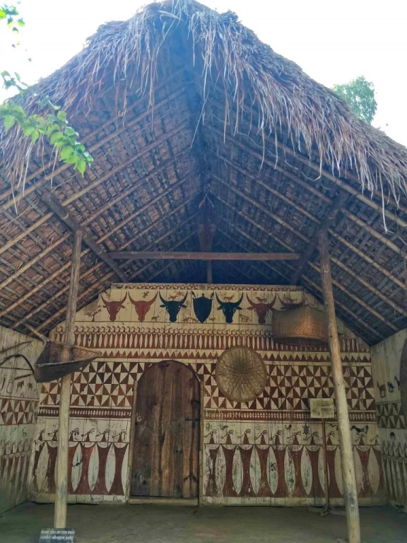 A Kabui house displaying different woven baskets – these are designed to make carrying load on longer distances easier