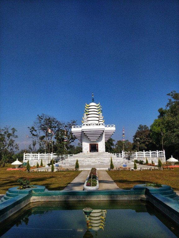 The beautiful Ibuthou Pakhangba Temple surrounded by lush greenery in Kangla Fort. Pakhangba is a supreme God in a traditional belief that precedes Hinduism