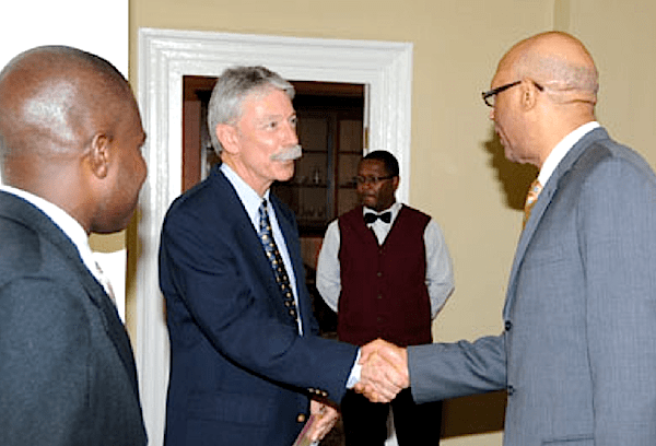Pastor Phillip Lee sharing with His Excellency, Governor General of Jamaica, Dr. Patrick Allen.