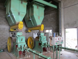 Briquetting machine with Holding Bin and Cooling Line