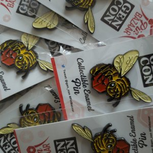 A pile of Bee Pins for the Gen Con Pin Bazaar