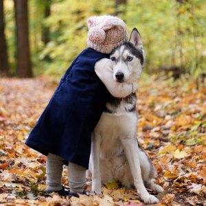 kid hugging dog