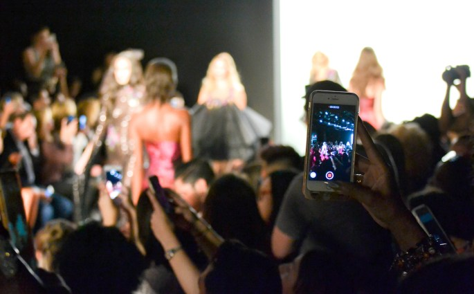 Attention to all blogger and editor friends covering fashion week: Put down your phones and take off the sunglasses.